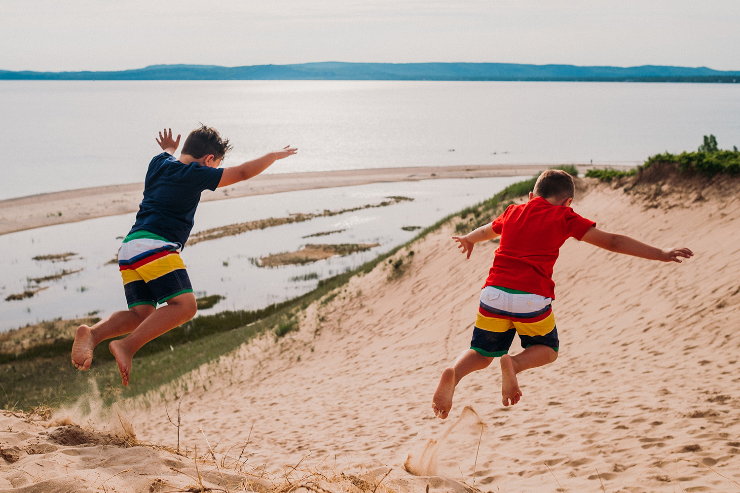 Kids Jumping Dunes Northern Michigan
