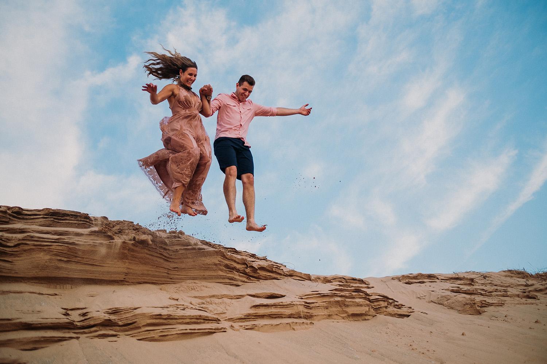 Couple Dune Jump Sleeping Bear