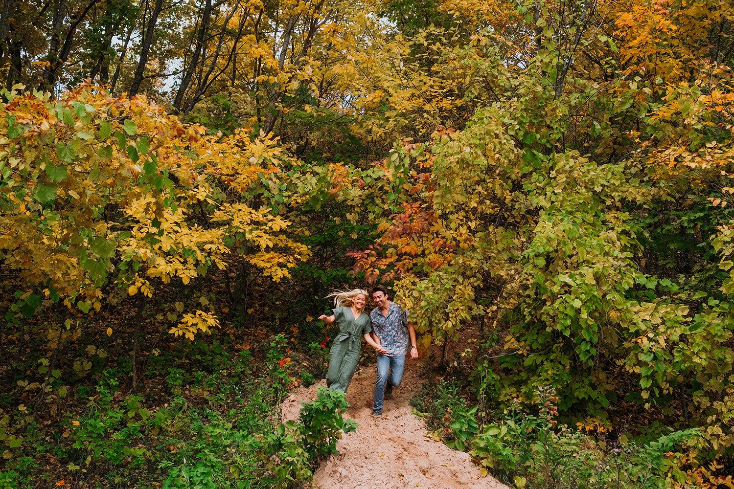 Fall Color Couple Running Forested
