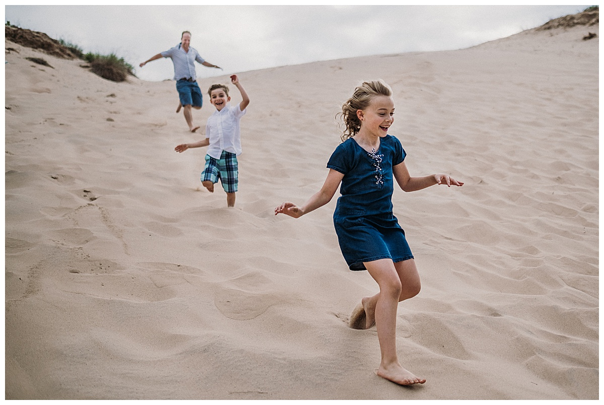 Family Running Down the Dunes Sleeping Bear