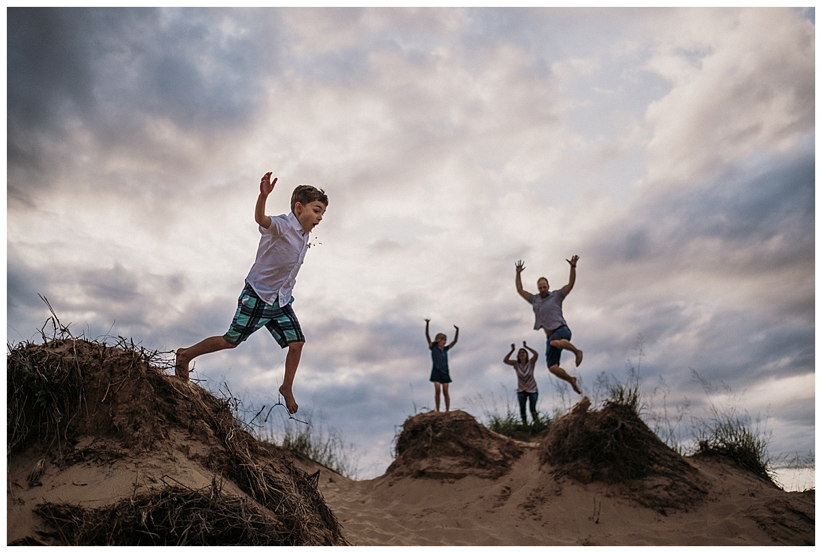 Family Jumping at the Dunes Sleeping Bear