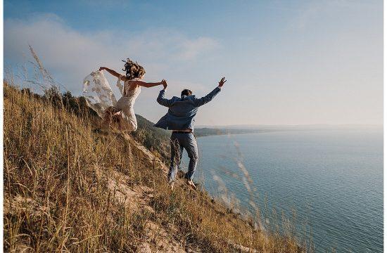 Bride and Groom Jumping off the Dunes Sleeping Bear Dunes