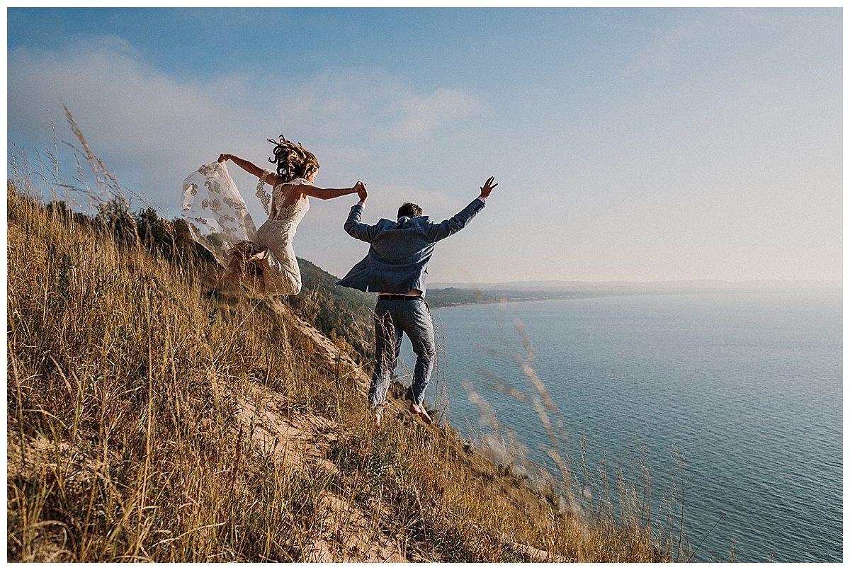 Bride and Groom Jumping off the Dunes Sleeping Bear Dunes