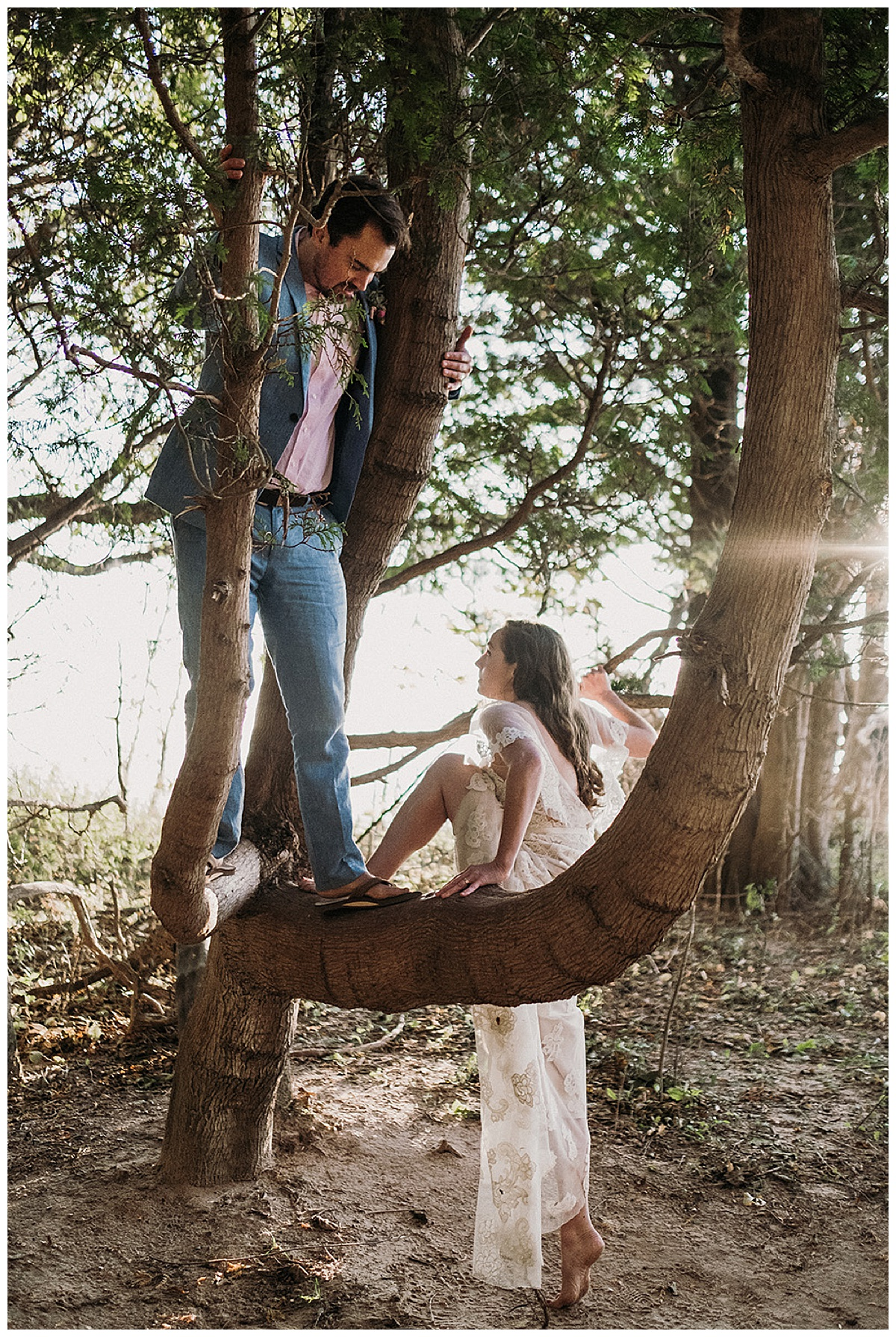 Bride and Groom Climbing Tree