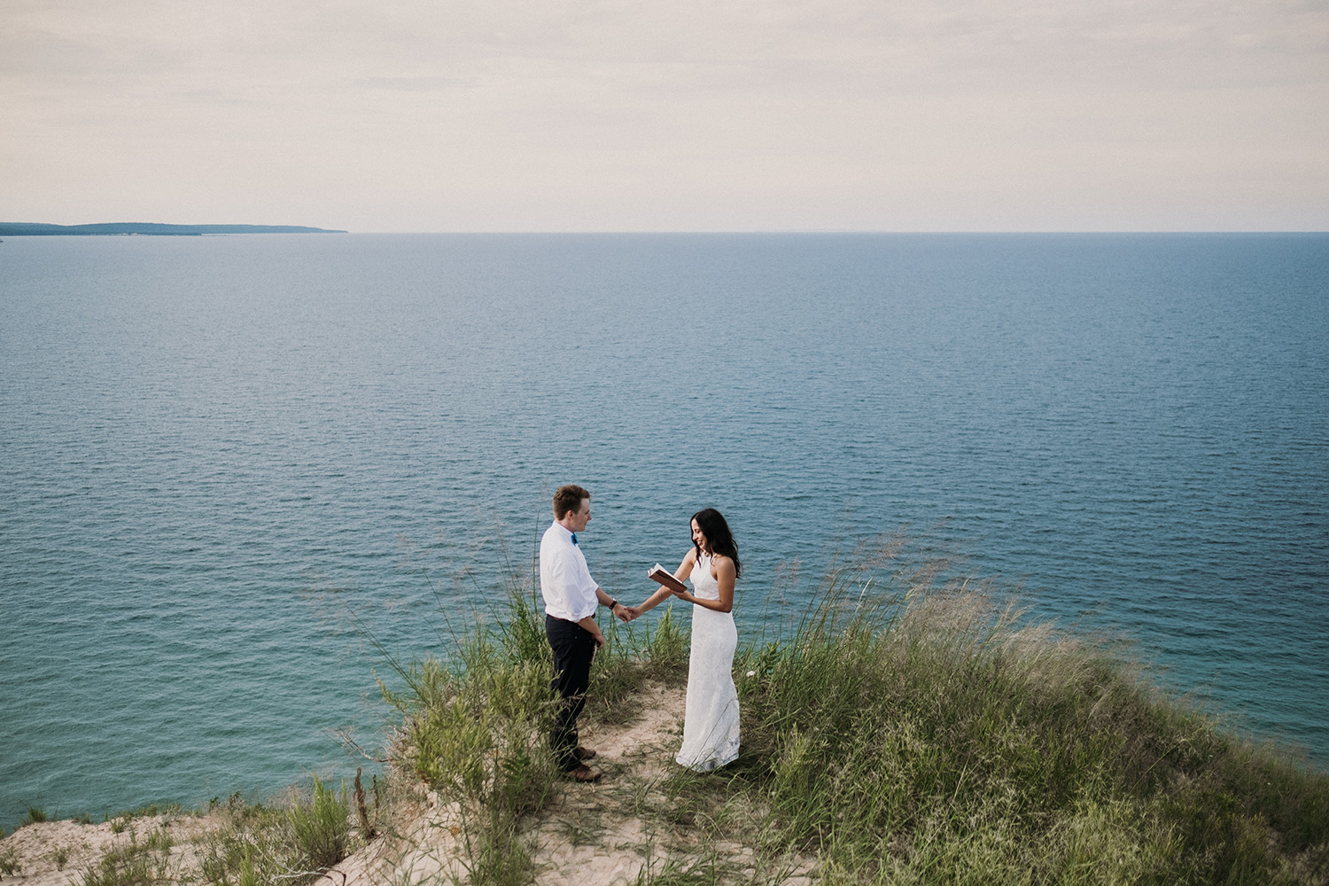 Couple Sharing love filled vows at sleeping bear dunes with Josh Hartman
