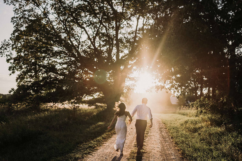 Non traditional couple runs towards glow of sun with Josh Hartman
