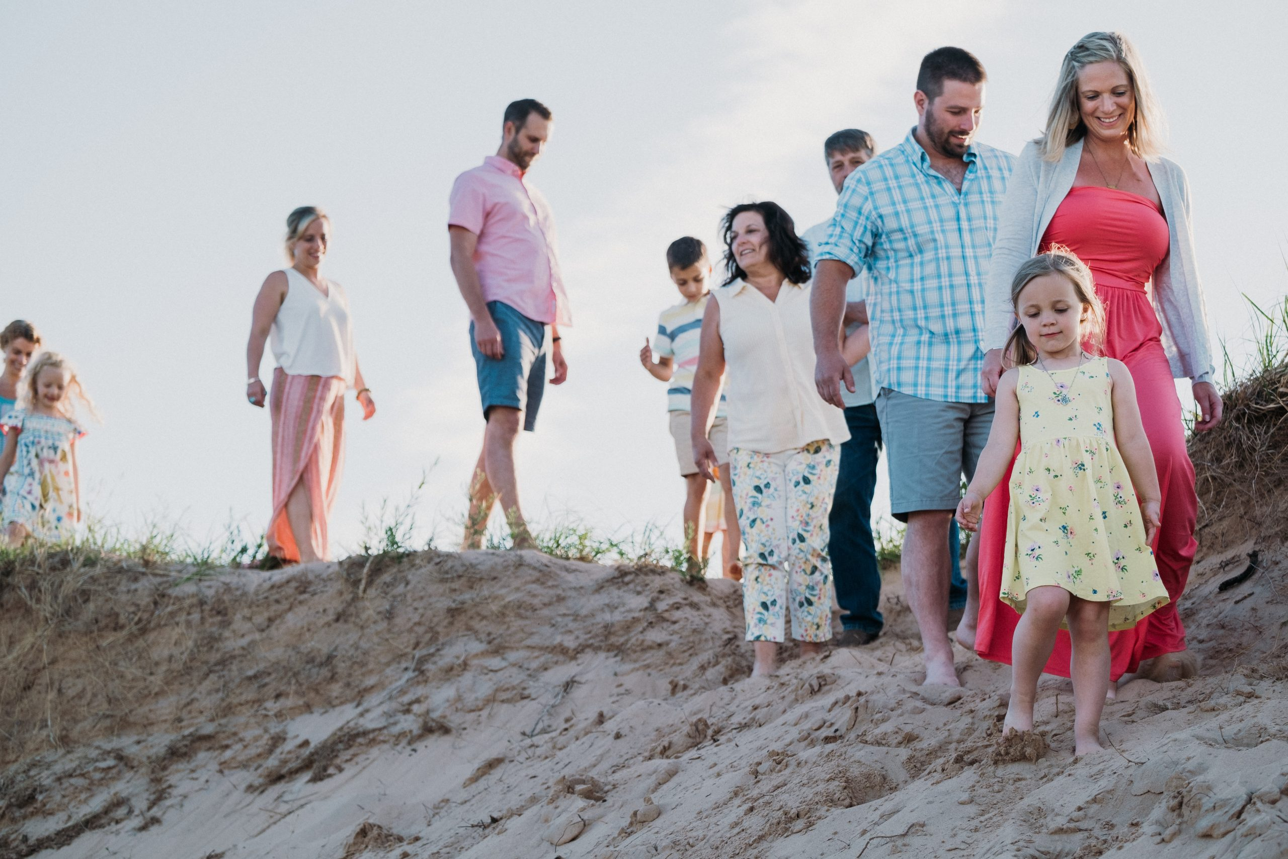large family standing on dunes during family adventure session