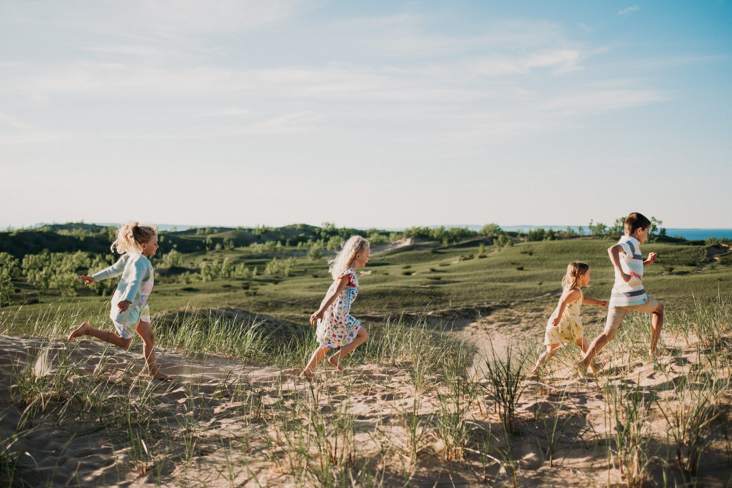 three girls chasing each other during family adventure session