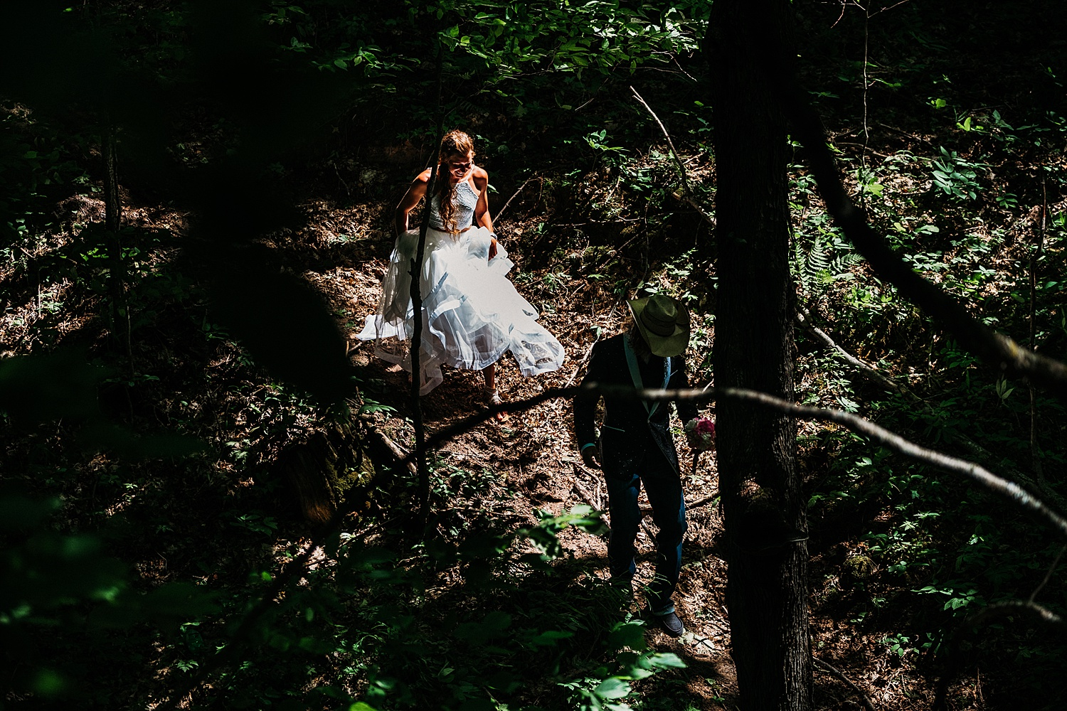 Bride and Groom Hiking in Dark Forest
