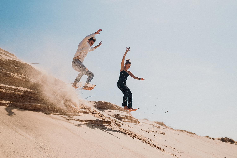 Northern Michigan Dunes Couple Jumping