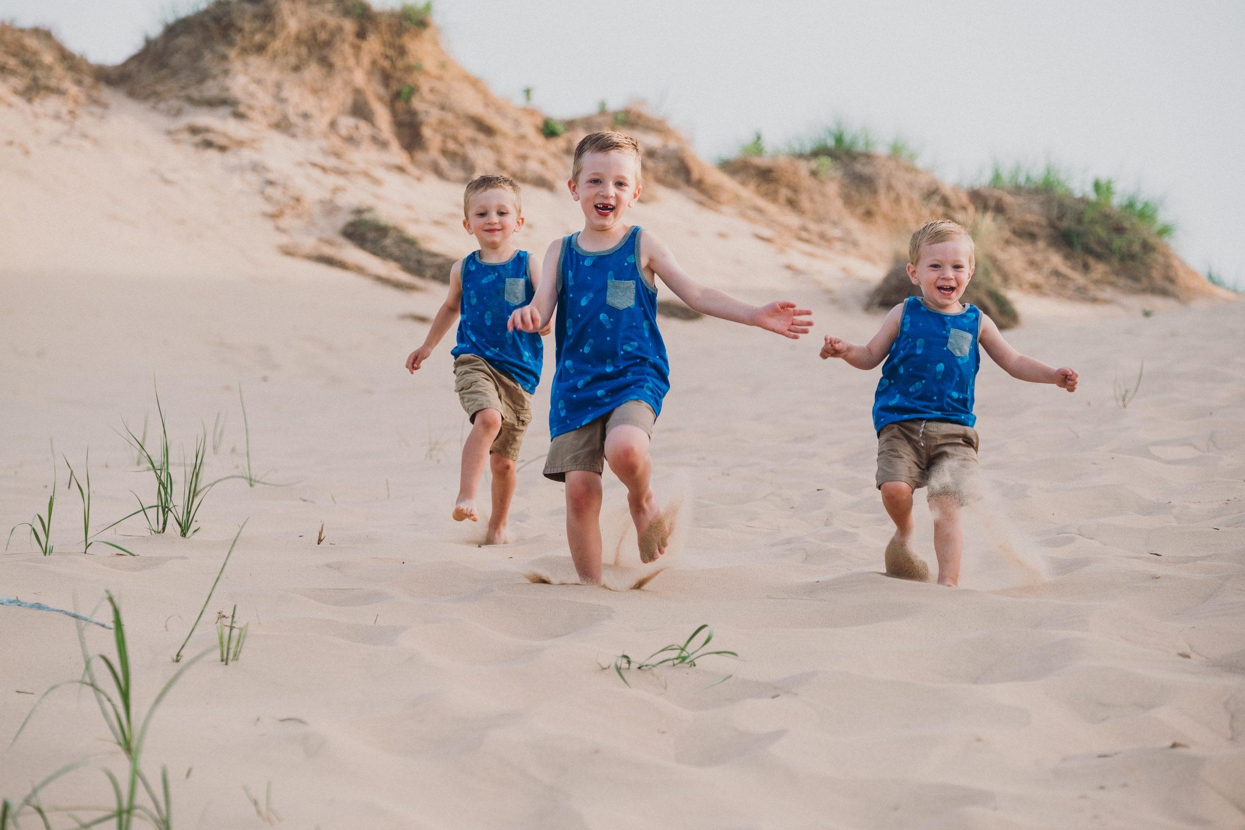 Boys Running Sleeping Bear Dunes Family Photographer